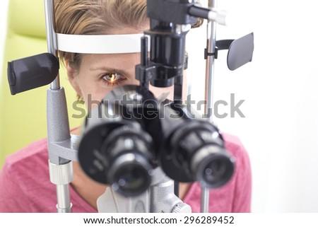Eye examination at the slit lamp - stock photo