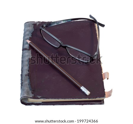 eye glass and pencil on old brown diary note book  - stock photo