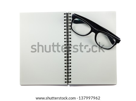 Eye glasses and binder notebook on white - stock photo