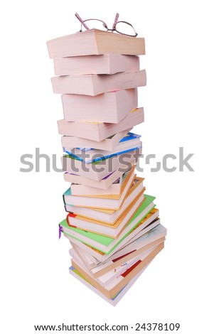 eye glasses on the stack of books isolated on white - stock photo