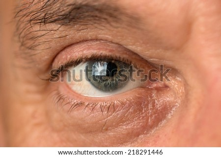 eye of a middle aged man - stock photo