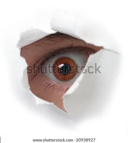 Eye peering out hole in sheet of paper on the white background - stock photo