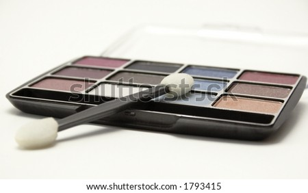 Eye shadow compact on white background. Shallow DOF. - stock photo