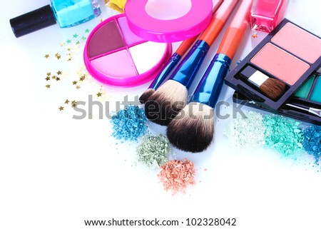 eye shadow, nail polish and make-up brushes isolated on white - stock photo