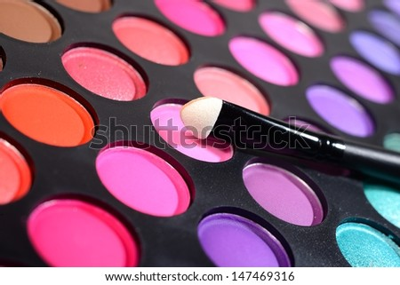 Eye shadows make-up palette and a brush close-up - stock photo
