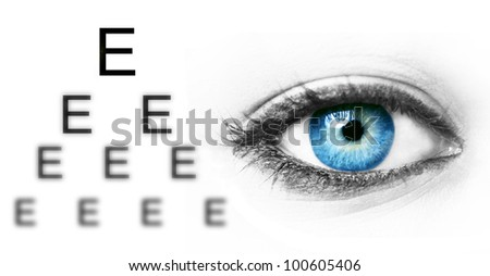 Eye test chart and blue human eye - stock photo