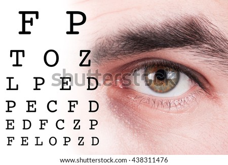 Eye test vision chart with man eyes background - stock photo