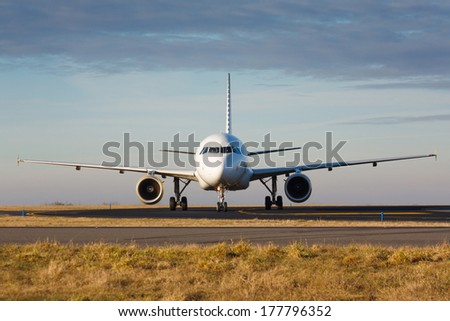 Eye to eye view with taxiing plane - stock photo