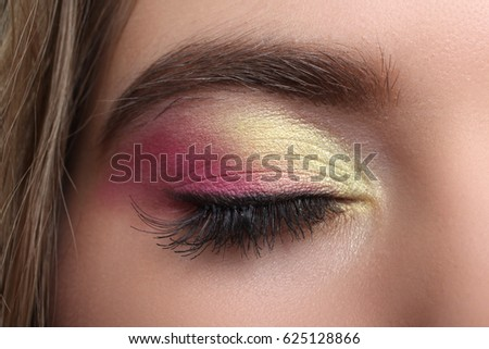 Eye with pink make-up, close-up