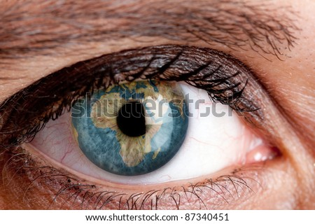 Eye with the earth inside - stock photo