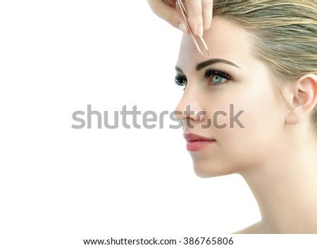 Eyebrow correction. Eye brow correction procedure for the model with long eyelashes - stock photo
