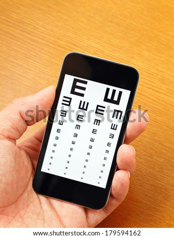 Eyechart on mobile - stock photo