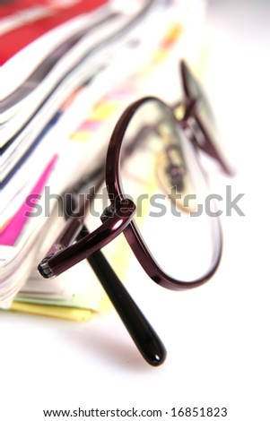 Eyeglasses and newspapers - stock photo