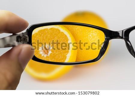 Eyeglasses looking for orange - stock photo