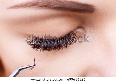 Eyelash Extension Procedure. Woman Eye with Long Eyelashes. Lashes, close up, macro, selective focus