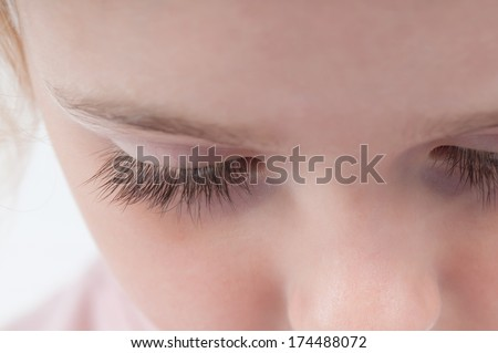 Eyelashes of a young girl. - stock photo
