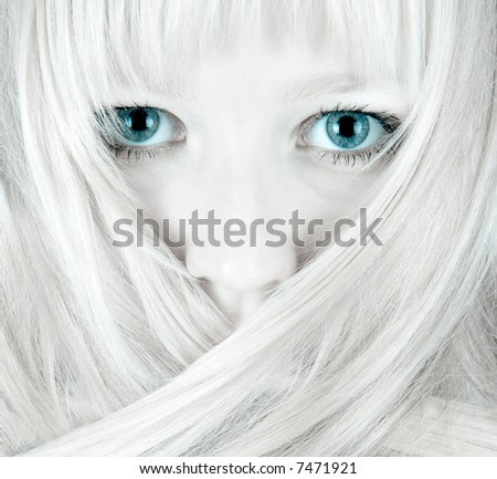 Eyes and hair - serious look - stock photo