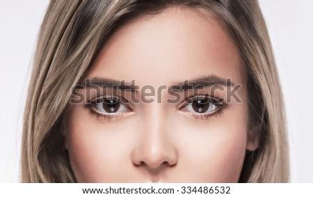 Eyes Beautiful woman face portrait close up studio on white - stock photo