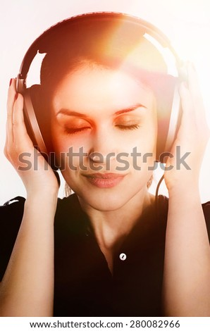 Eyes Closed Young Woman With Earphones Listening Music Enjoying - stock photo