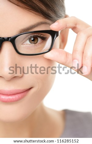 Eyewear glasses woman closeup portrait. Woman wearing glasses holding frame in close-up. Beautiful young mixed race Caucasian / Asian Chinese female model on white background.