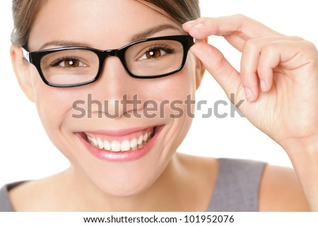 Eyewear glasses woman happy holding showing her new glasses smiling on white background. Beautiful young multiethnic Asian Chinese / Caucasian female model in her twenties. - stock photo
