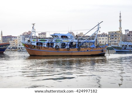 Ezbet el-Borg, Egypt - May 13 ,2016: Fleet of wooden fishing boats in the fishing city of Ezbet el-Borg,The city is situated on the northern coast of Egypt at the mouth of the Damietta river.