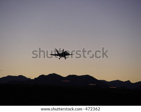 F/A-18 Hornet makes an approach to land at sunset in NW Denver. - stock photo