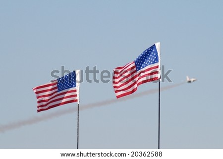 F-16 and American Flags - stock photo