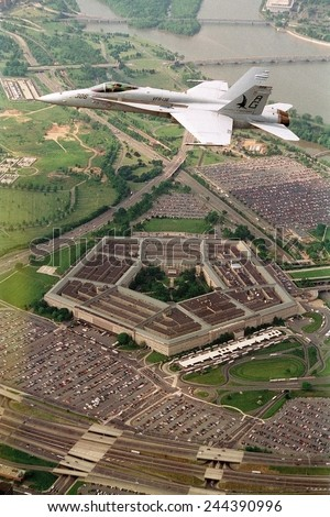F-18 Hornet fighter flies over the Pentagon. - stock photo