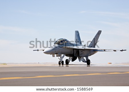 F-18 Hornet military fighter aircraft taxis for takeoff - stock photo