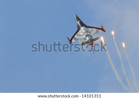 F16 shooting flares for defense - stock photo