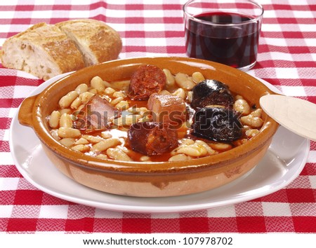 Fabada Asturiana. Traditional Spanish meal native from Asturias Region. Made with White Beans, red spicy sausage, black sausage and Bacon. - stock photo