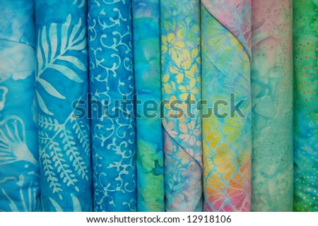 Fabric bolts - Blue batik prints - stock photo