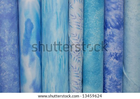 Fabric bolts - blue prints - stock photo