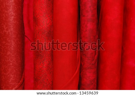 Fabric bolts - red prints - stock photo