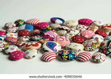 fabric buttons isolated on white background / selective focus - stock photo