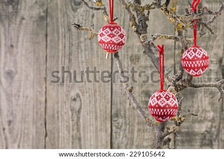 Fabric Christmas balls hanging on wooden background - stock photo