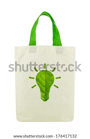 Fabric eco bag with light bulb icon made of green leaf, Isolated on a white background.Green eco energy concept. - stock photo
