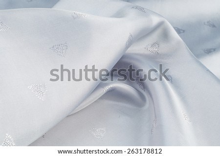 fabric gray white. tissue, textile, cloth, fabric, material, texture. cloth, typically produced by weaving or knitting textile fibers. - stock photo
