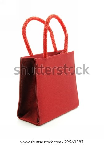 Fabric red hand bag with shine handle isolated on white background, - stock photo