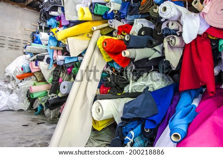 Fabric rolls in shelf for fashion industry  - stock photo