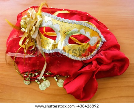 fabric, sewn coins for belly dance, passion skirt, Golden carnival Mask, flower of taffeta - stock photo