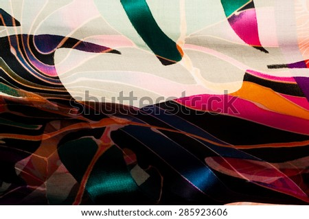 Fabric silk texture. abstract painting. bstract wave pattern on silk batik. a fine, strong, soft, lustrous fiber produced by silkworms in making cocoons and collected to make thread  - stock photo