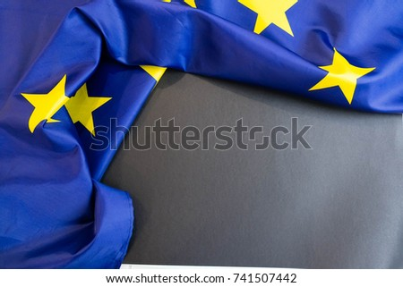Fabric texture flag of European Union chalkboard with space for tex