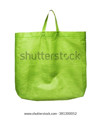Fabric tote green bag with handle isolated on white background - stock photo