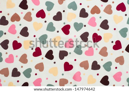 Fabric with colorful heart pattern design useful for textures and background. - stock photo