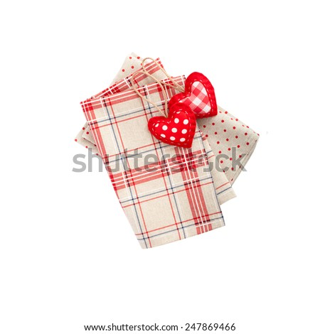 Fabrics and accessories for decoration. Tablecloths and napkins for the table isolated. Heart made of cloth. - stock photo
