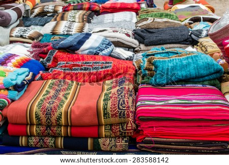 Fabrics on Traditional Market on Andes Civilization - stock photo