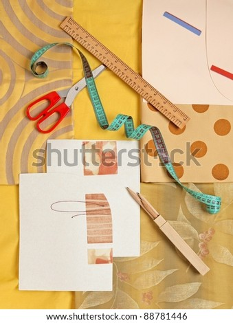 fabrics with measuring tools - stock photo