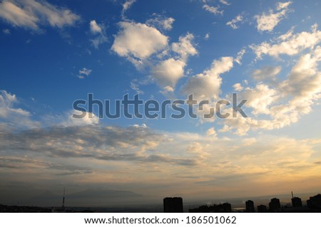 Fabulous cloudscape over the city - stock photo